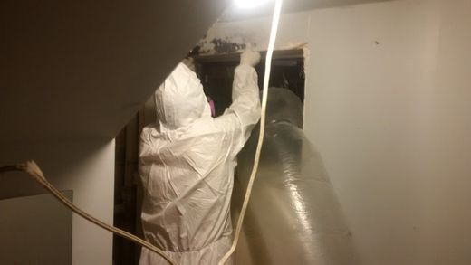 Professional installing asbestos moulding